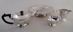An Art Deco style tea service with rounded cut out