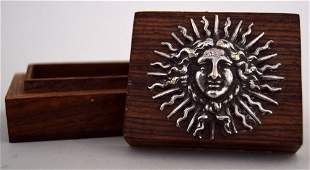 A small rosewood box applied with a white metal ''Le