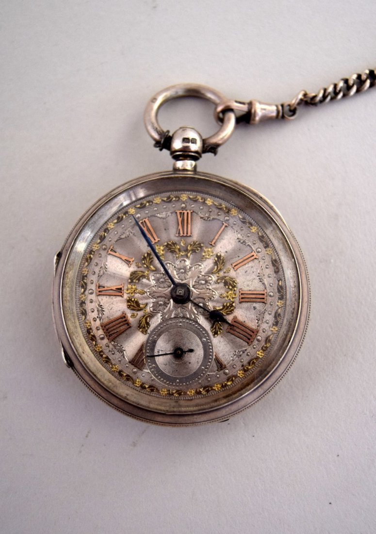 A late Victorian pocket watch with silver and gilt face