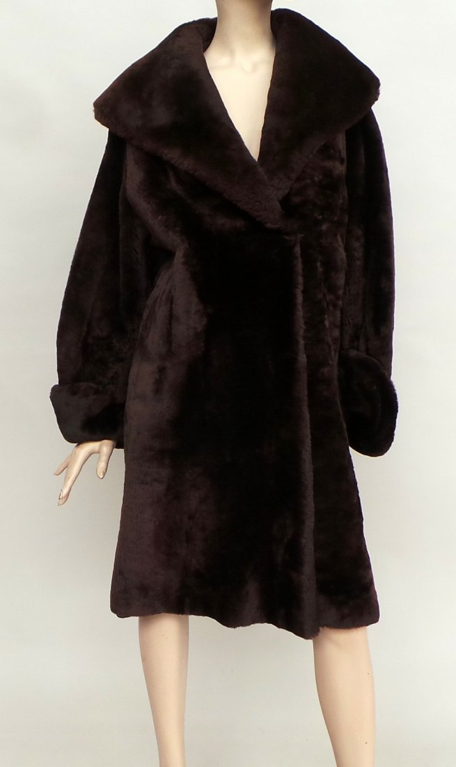 A lambswool fur lined coat with shawl collar and a fur
