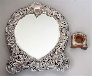 An Edwardian repousse silver strut mirror