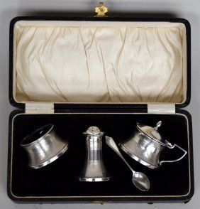 A cased silver and Bakelite cruet set