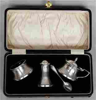 A cased silver and Bakelite cruet set