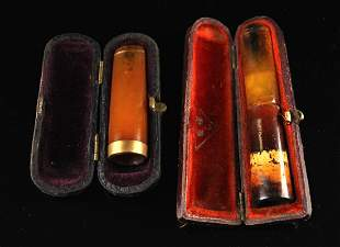 Two Pieces of Amber & 10K Gold Cigarette Tips