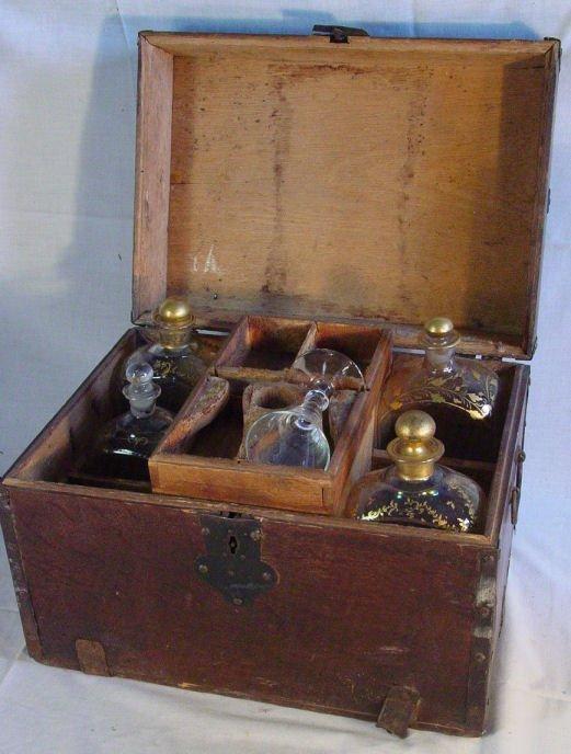31: Cased antique sea captains liquor chest