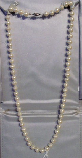 23: Pearl necklace