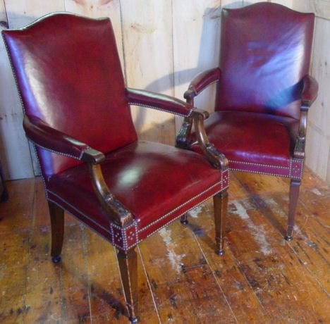 152: Pair leather lolling chairs