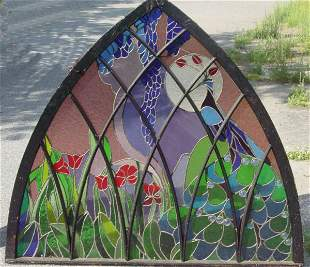 Gothic arch stained glass window with peacock