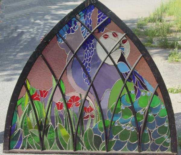 9: Gothic arch stained glass window with peacock