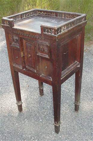 Gothic style walnut stand, circa 1900, gallery top,