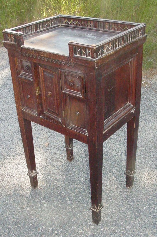 15: Gothic style walnut stand, circa 1900, gallery top,