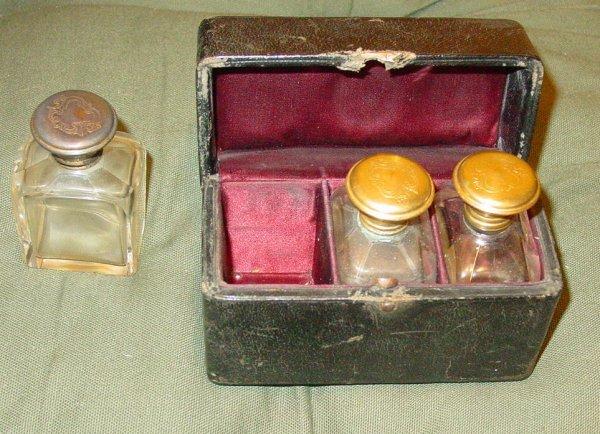 1004: cased set perfume bottles