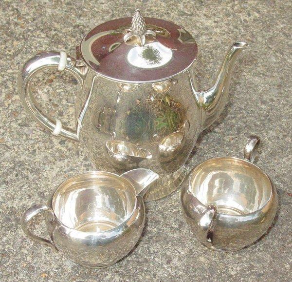 1024: 3 piece sterling tea set