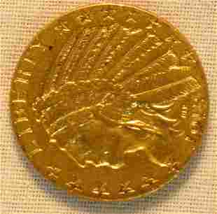 1913 $5 gold US coin,