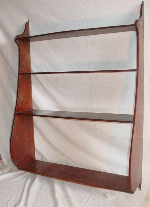 16: Early 19th c. mahogany whale shelf