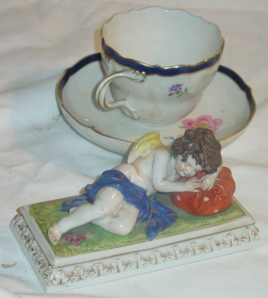 9: Porcelain figurine & Meissen cup and saucer