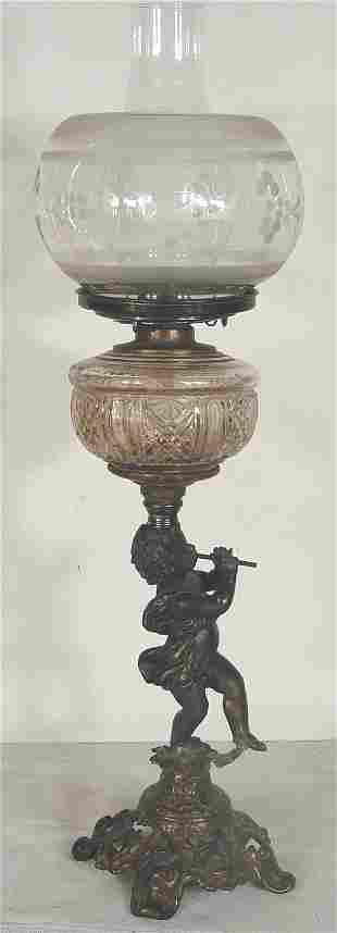 Victorian fluid lamp, cherub form base