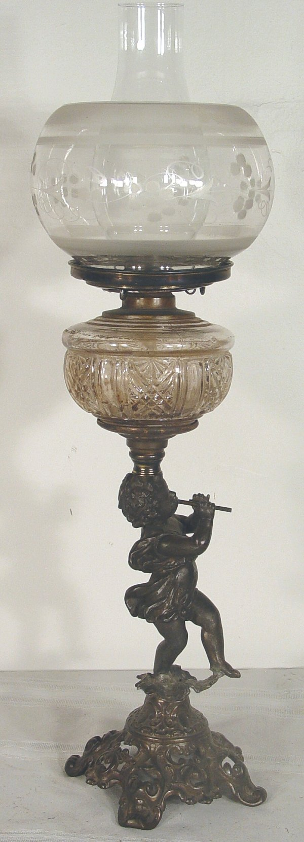1016: Victorian fluid lamp, cherub form base