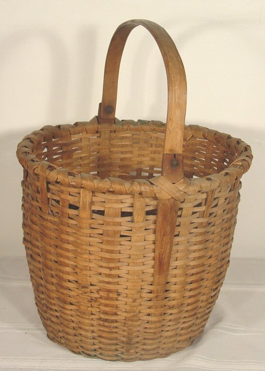 "1020: large antique split handled basket, 12"" t"