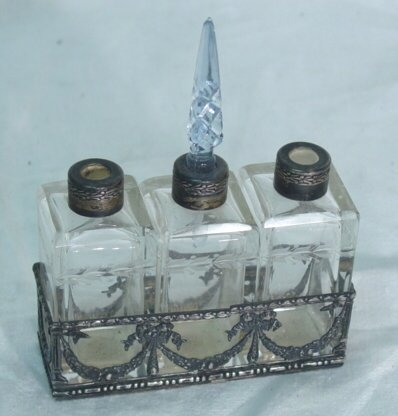 "1: Three 3"" tall perfume bottles in Sterling"