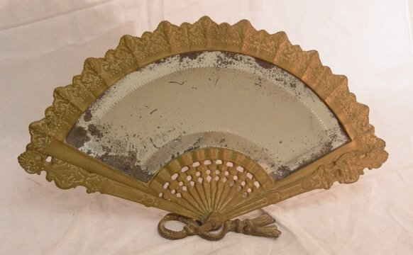 12: Victorian brass table mirror in fan form,