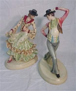 two flamingo dancer figurines