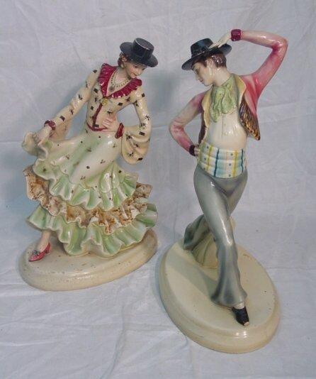 1001: two flamingo dancer figurines