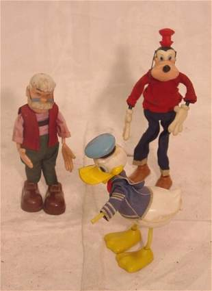 four Disney character dolls including Mickey