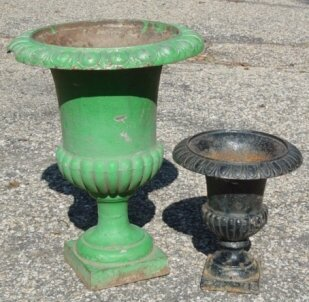 13: two Antique cast iron urns