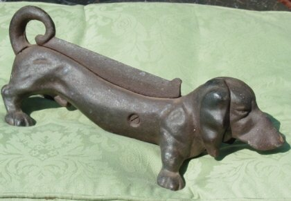 18: Old cast iron dog bootscaper