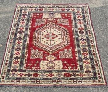 1012: Oriental Kazak scatter rug