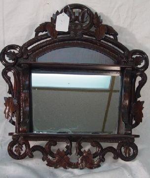 1021: Victorian carved walnut mirror