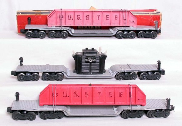 14: Two Lionel 6418 flatcars and a 6518 flatcar