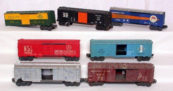 8: Seven Lionel 6464 postwar boxcars