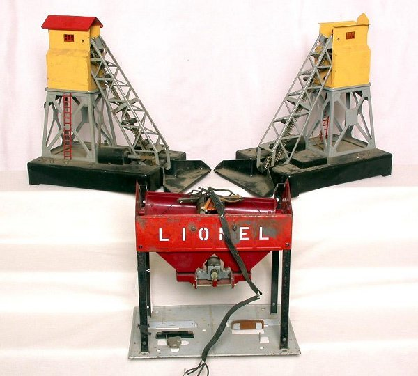 17: Two Lionel 97 coal loaders and a 497 coaler
