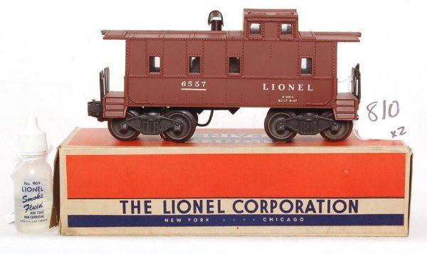 810: Nice Lionel 6557 smoking caboose in OB