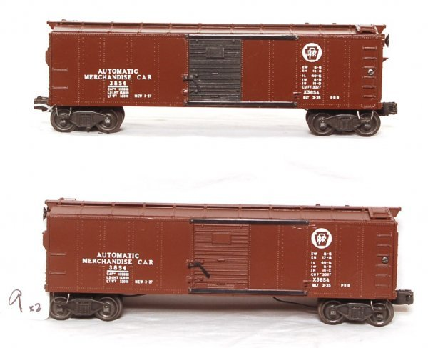 9: Two Lionel 3854 PRR operating merchandise cars