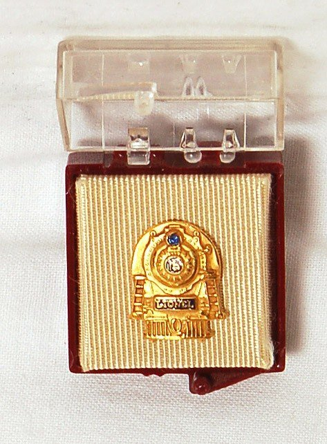 808: Unusual Lionel 15 year service pin for women