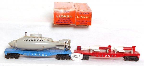 2813: Lionel 3330 sub flatcar, 6823 missile flatcar, OB