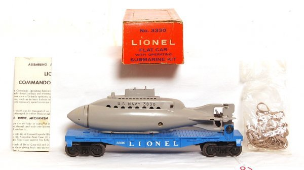 2806: Unrun Lionel 3330 flatcar with operating sub, OB