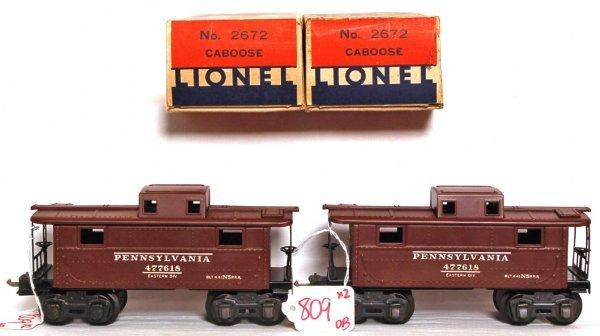 809: Unrun Two Lionel prewar 2672 PRR cabooses OB
