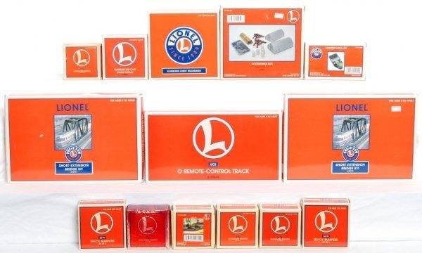 24: Fourteen Lionel accessories in original boxes
