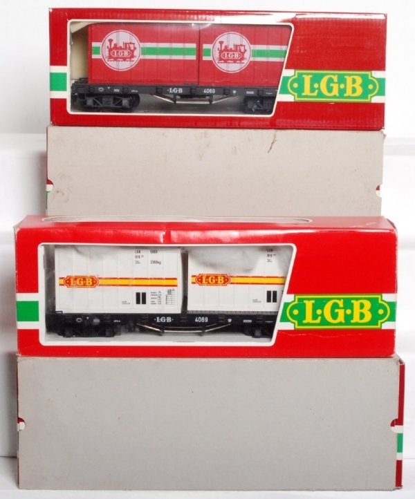 23: Four LGB G scale 4069 flatcars w/containers in OB