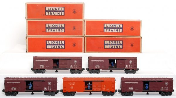 22: Five Lionel 3484 operating boxcars in OB