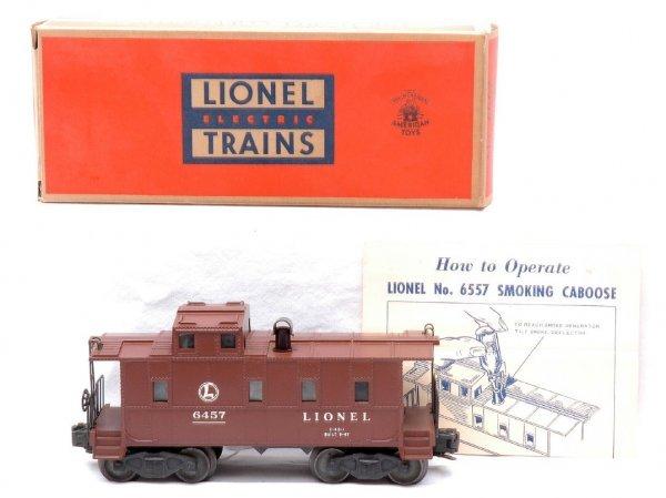 523: Lionel 6557 Illuminated Smoke Caboose LN OB