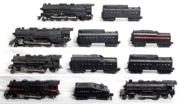 13: Five Lionel locos and six tenders, all postwar