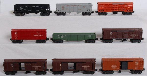15: Nine pieces of postwar Lionel O gauge rolling stock