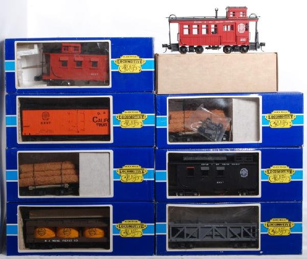 18: 8 Delton Cabooses, log cars, boxcars Etc.