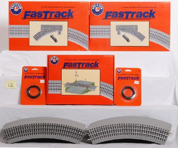 12: Lionel FasTrack switches, grade crossing, curves