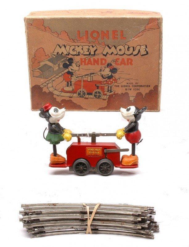 81: Lionel 1100 Mickey/Minnie Red Wind Up Hand Car